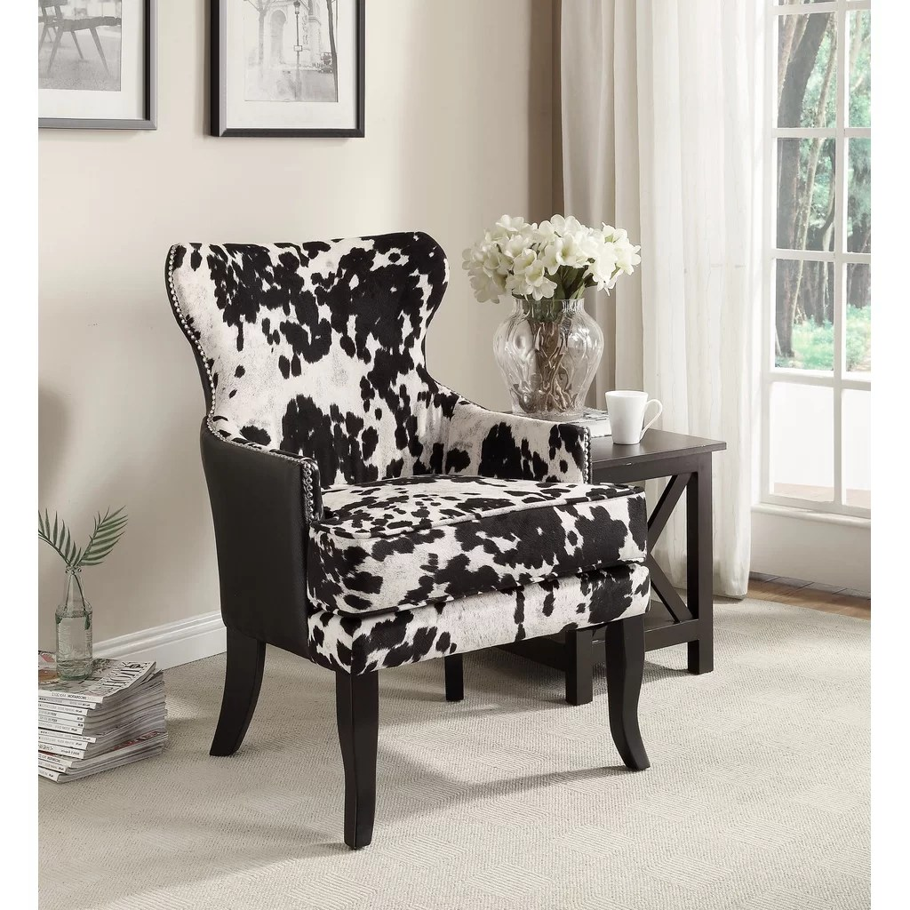 cowhide print accent chair eating chairs for toddlers nspire faux with stud detail