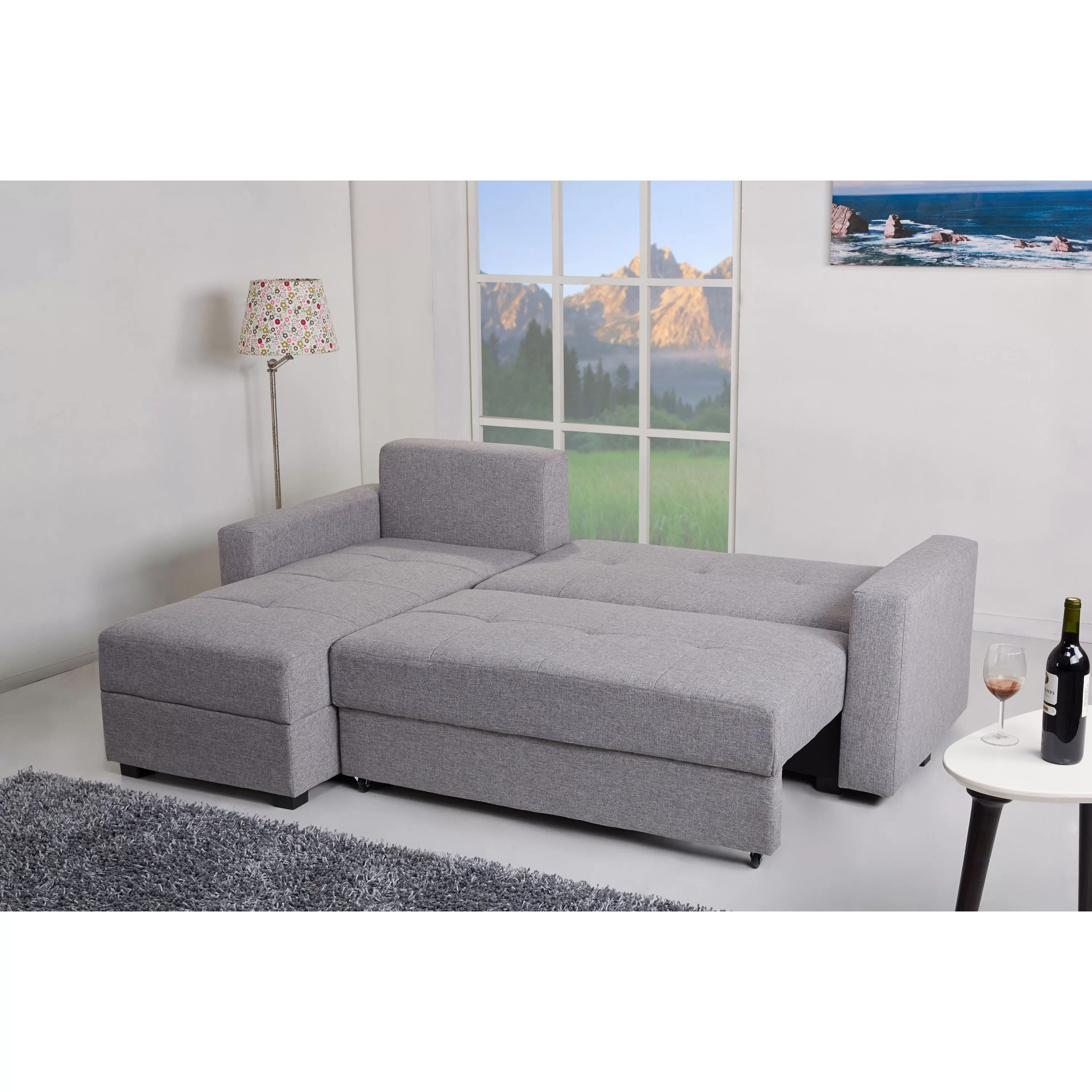 aspen convertible sectional storage sofa bed cinema manhattan faux leather gold sparrow reversible chaise and reviews
