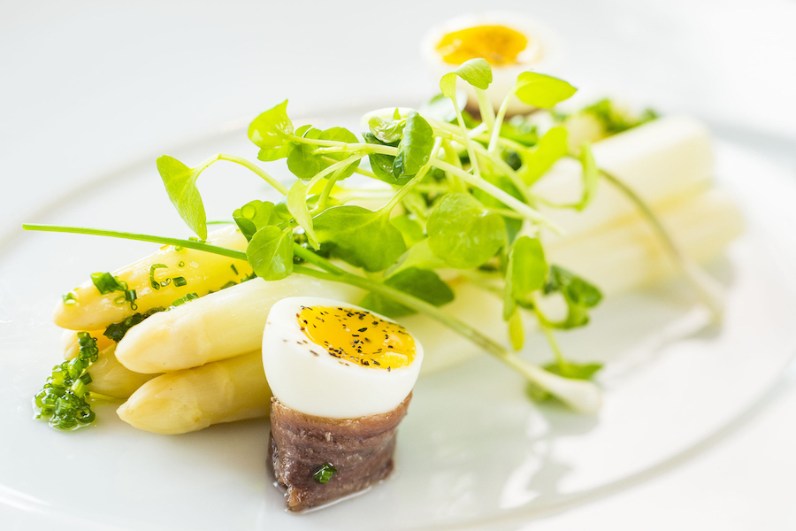 white asparagus with smoked anchovies, quail egg and truffle oil from Palo on Disney Cruise Line ships