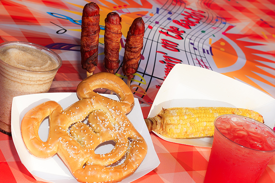 """Mickey-shaped pretzels, """"Wrap""""sody in Bacon BBQ bacon-wrapped hot dogs and """"Corn""""certo on the Cob chili lime elote at JamminBacklot at Disney California Adventure Park"""