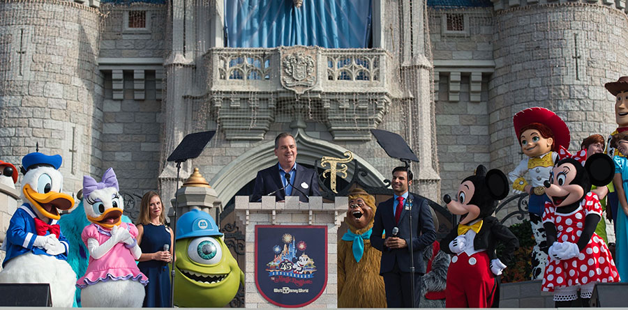 """Walt Disney World Resort marked its 45th anniversary Saturday, Oct. 1, 2016, with a flurry of 45 beloved Disney characters in a colorful fanfare at Magic Kingdom Park. The celebration hit a high note with a special live arrangement of """"When You Wish Upon a Star,"""" underscored by a burst of pyro magic and colorful streamers shot high above the Kingdom. (David Roark, photographer)"""