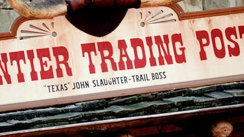 A close-up of the Frontier Trading Post sign in Frontierland at Magic Kingdom
