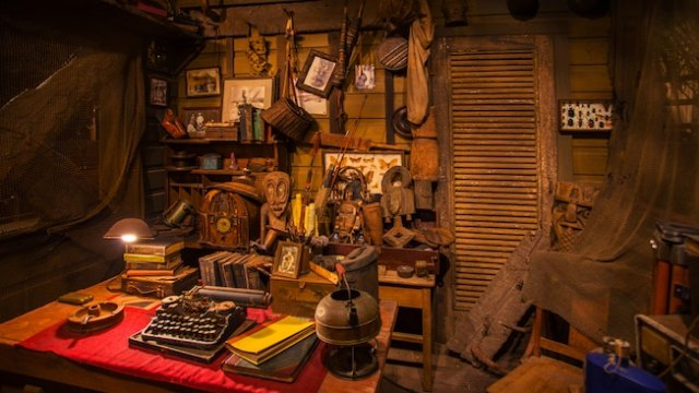 An explorer's typewriter, books and mementos on a desk in his room at the Jungle Cruise attraction