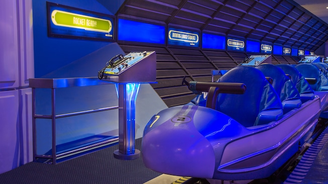A rocket-shaped train at the loading dock at Space Mountain