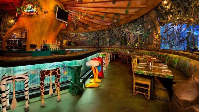 Animal-leg barstools at bar