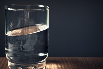 slanted water in glass cup