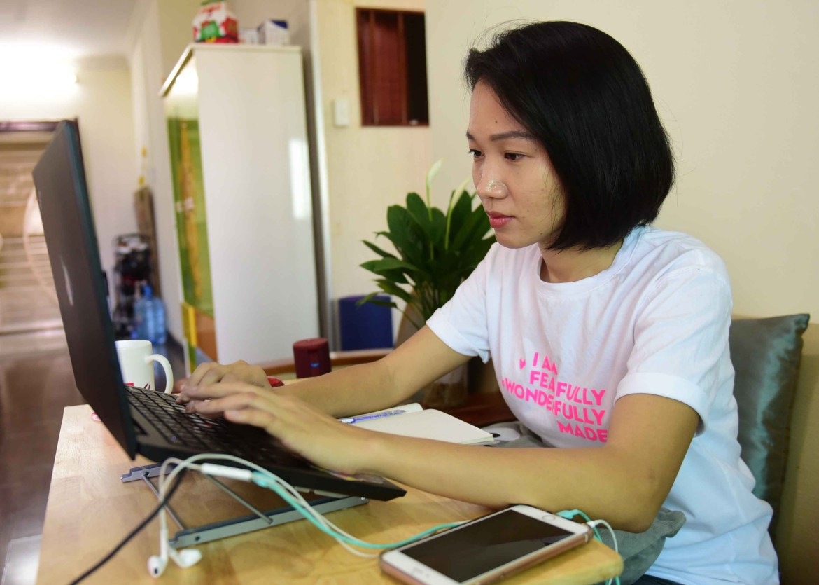 <em>A woman works from home in District 2, Ho Chi Minh City, March 2020. Photo:</em> Quang Dinh / Tuoi Tre
