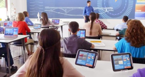 Students in classroom with personal devices