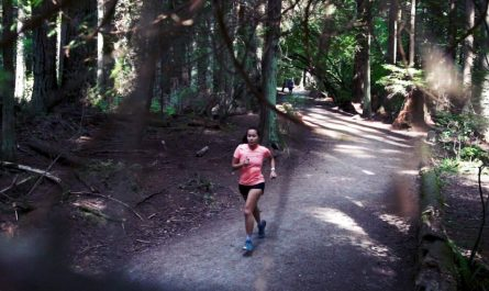 Trail runner running through Pacific Spirit Park