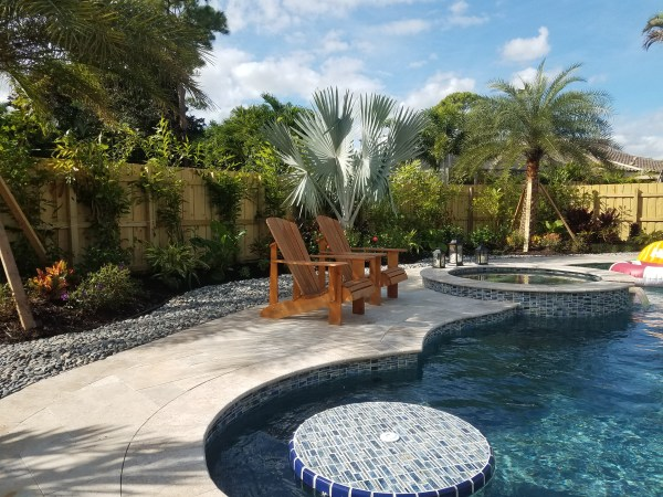 swimming pool with tropical landscape