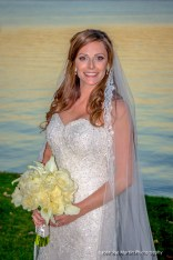 Happy bride posing for a wedding portrait
