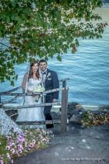 Posing lake side for a bridal portrait