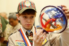 Cub Scout Clinton Kuropkat, 11, of Crossfield Elementary School, looks at a Perplexus during the STEM Symposium.