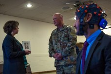 Army researcher Dr. Jean Vettel (left) explains how her team is using neuroscience to understand and enhance manned-unmanned teaming during a brief to Maj. Gen. Jim Richardson Aug. 23, 2016, at Aberdeen Proving Ground. Photo: ARL