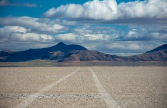 My uninterrupted car tracks on the dry lake bed in the Alvord Desert