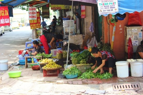 Corner produce market in French Quarter Hanoi, Vietnam