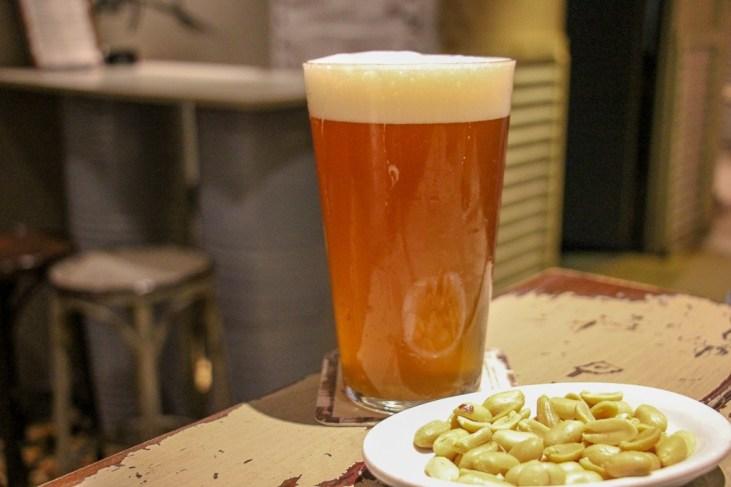 Craft beer and peanuts at Abirradero Craft Beer Bar in Barcelona, Spain