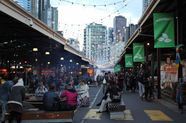 At the Queen Victoria Market night event, blazing fires keep people warm