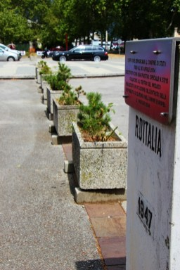 Border between Italy and Slovenia marked with plants in Europe Square