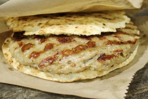 Grilled meat Pljeskavica burger in Belgrade, Serbia