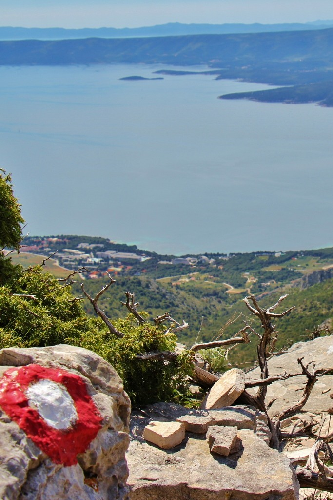 Trail marker and sea view near Vidova Gora peak on on Brac, Croatia