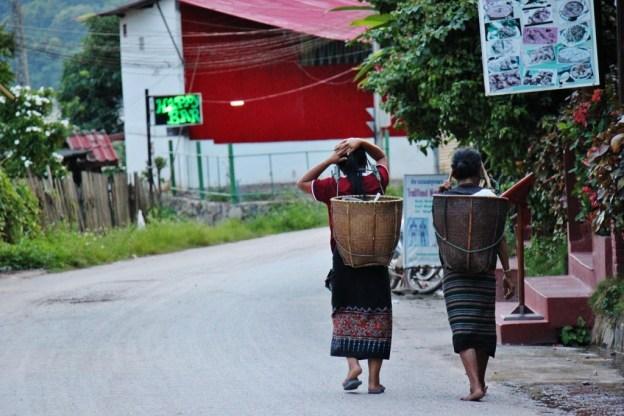 Women carrying baskets in Pakbeng, Laos