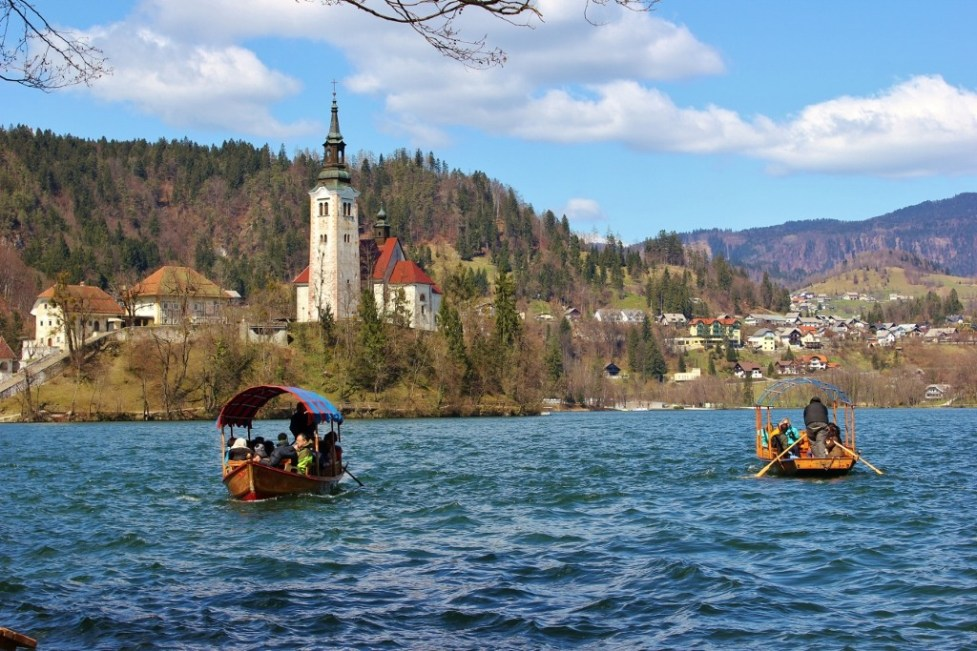 Pletna Boats rowing to Bled Island on Lake Bled, Slovenia