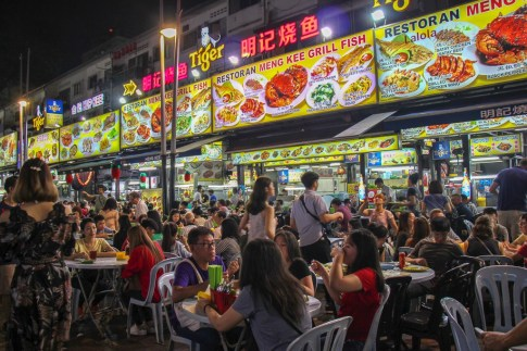 Diners at Street Food Stalls on Jalan Alor Food Street in Kuala Lumpur, Malaysia