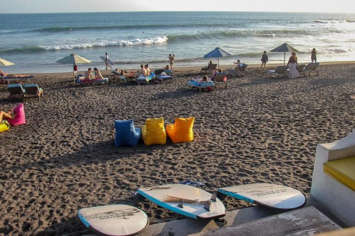 Surf boards and beach bean bags on Echo Beach in Canggu, Bali, Indonesia