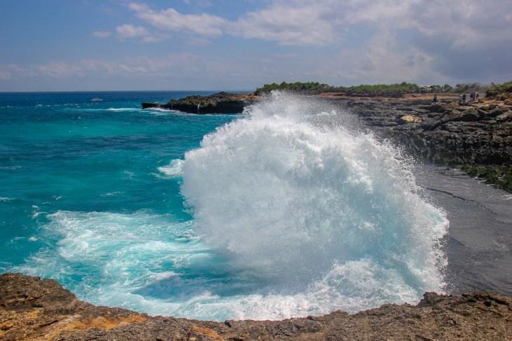 Waves crash against the rocks near Devil's Tears on Nusa Lembongan, Bali, Indonesia