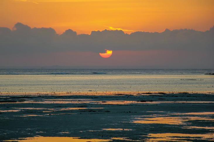 Orange ball sunset over Bali from Nusa Ceningan, Bali, Indonesia