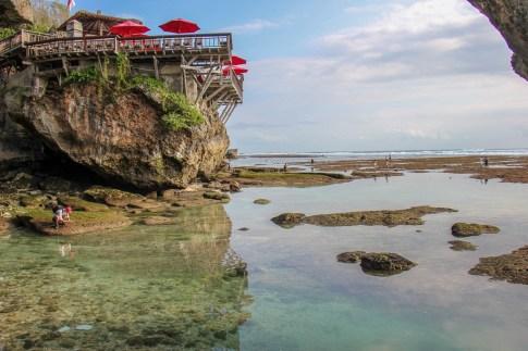 Low tide in Uluwatu Cave at Suluban Beach in Uluwatu, Bali, Indonesia