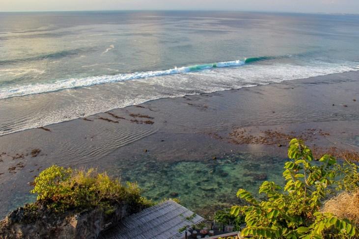 Peering down at the waves in Uluwatu, Bali, Indonesia