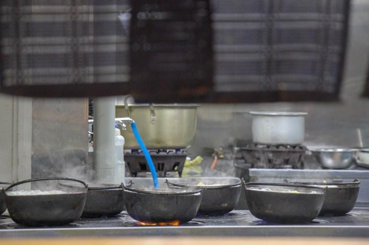 Preparing pots of Hoto Noodles in Hoto Fudo kitchen in Kawaguchiko, Japan