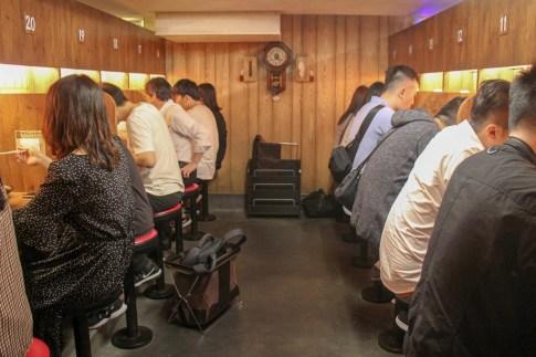 Diners eating at Ichiran Ramen in Tokyo, Japan