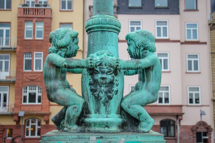 Lamppost statue on southern end of Eiserner Steg in Frankfurt, Germany