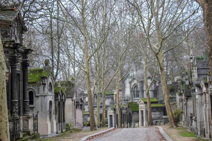 Pathway through gravestones in Per Lachaise Cemetery in Paris, France