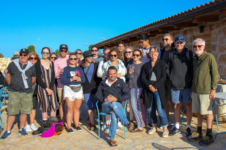 Group photo of Sail Croatia passengers at wine tasting in Stari Grad, Hvar Island, Croatia