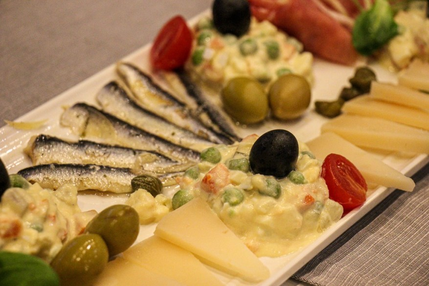 Starter plate of sardines, cheese, salad and meat at Captain's Dinner on Sail Croatia Explorer Cruise