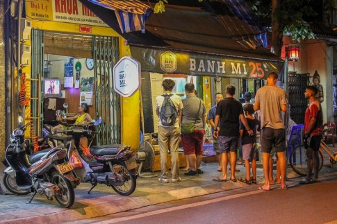 Line of patrons at Banh Mi 25 in Hanoi, Vietnam