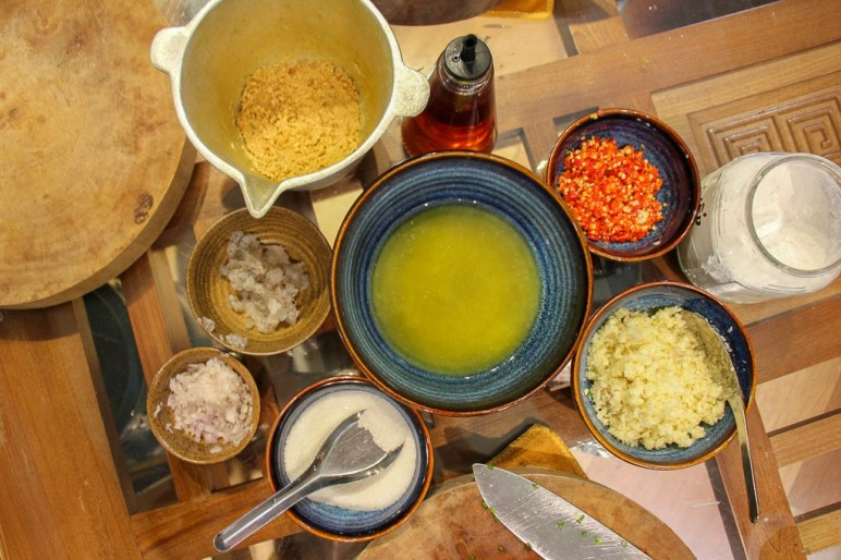 Preparing made-from-scratch sauces at Rose Kitchen Cooking Classes in Hanoi, Vietnam