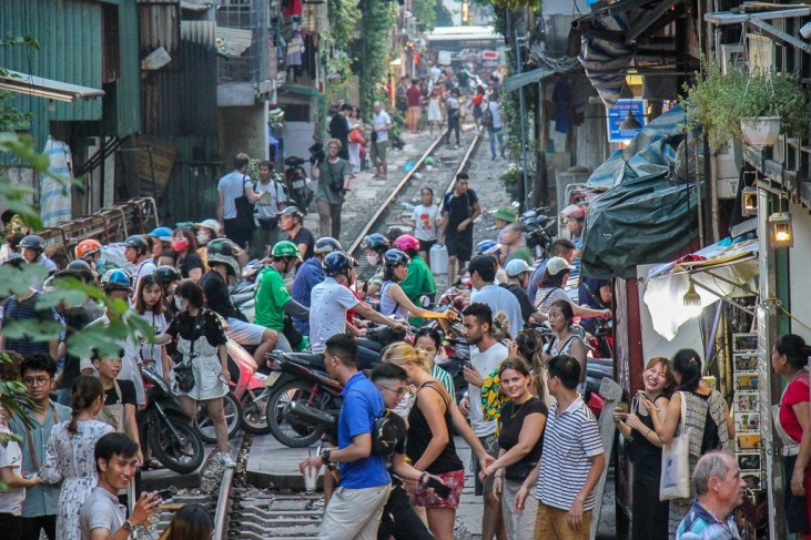 Street Traffic caused by train in Hanoi, Vietnam