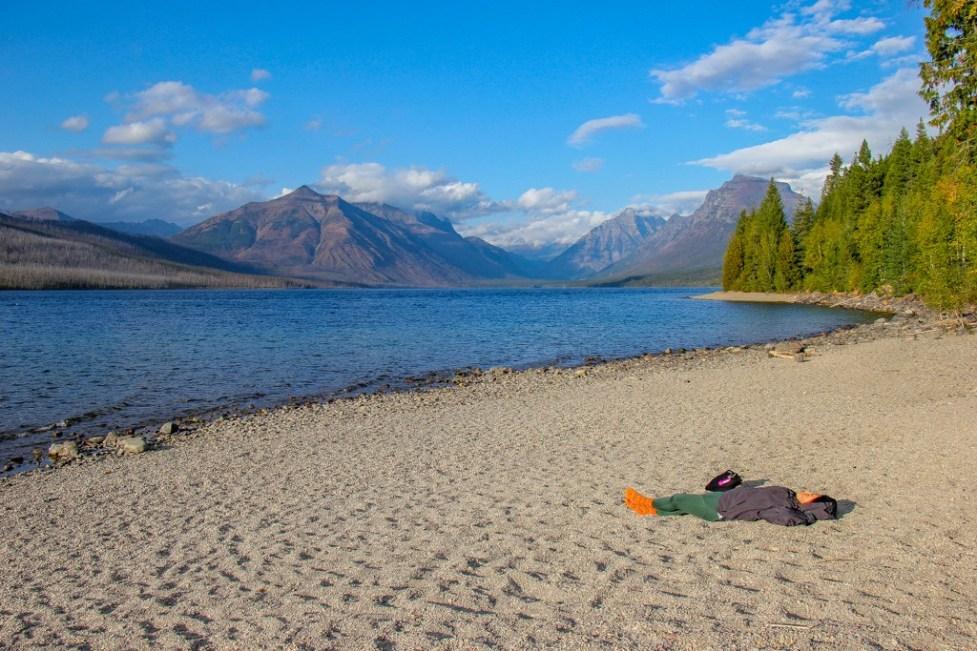 Yes, you can get a suntan at Lake McDonald Beach, Glacier National Park, Montana Road Trip