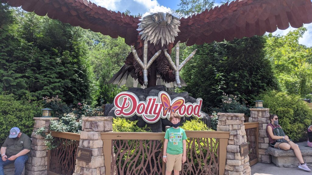 Evan Smith posing in front of the giant bald eagle sculpture at Dollywood