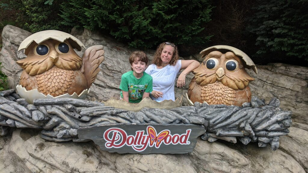 Michele and Evan inside a giant owl nest with baby owls. Photo opp area inside Dollywood's Wildwood Grove