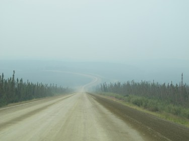 """A good shot of the recently graded gravel """"highway"""""""