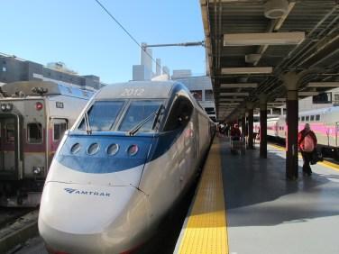 The Acela train pulled into Boston platform.