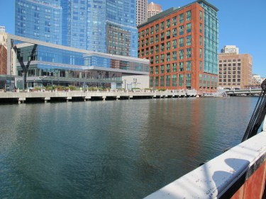 The red building with greenish windows is where the original pier would have been.