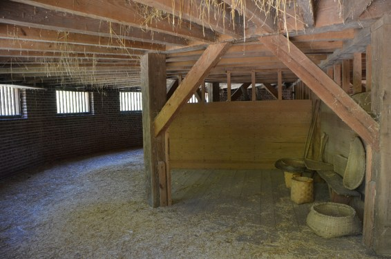The lower floor where loose wheat would accumulate