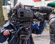 A cameraman filming on location